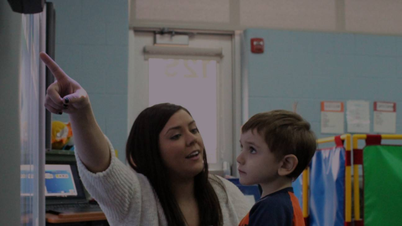 Teacher Kristin Rix works with a student